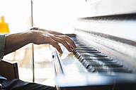 Close-up of man playing piano - DIGF000800