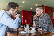 To men drinking coffee in a cafe - DIGF000803