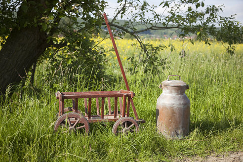 Germany, milk churn and handcart near field - KLRF000444