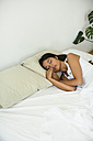 Young woman sleeping in bed - EBSF001546