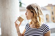 Italy, Italy, young woman with coffee to go - GIOF001335