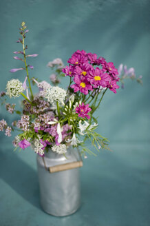 Bunch of wildflowers in milk can - GISF000230