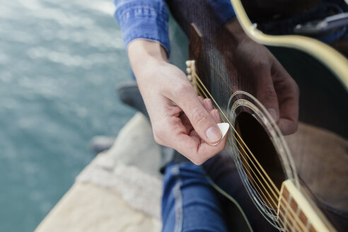 Young woman at the waterfront playing guitar - BOYF000501