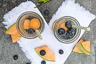 Two carafes of infused water with blueberries and melon - SARF002828