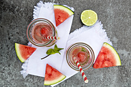 Two carafes of infused water with watermelon and lime - SARF002831