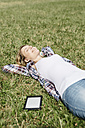 Young woman relaxing on a meadow - GIOF001363