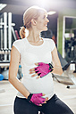 Pregnant woman doing exercises in gym - ZEDF000268