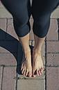 Woman's feet on pavement - BZF000322
