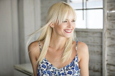 Portrait of happy blond woman in summer - GDF001098