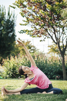 Young woman doing yoga in the park - BZF000325