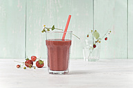 Strawberry smoothie in glass with drinking straw - ASF005964