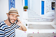 Greece, Amorgos island, young man talking on cell phone - GEMF000949