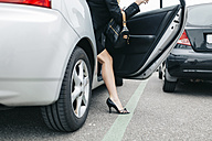 Woman wearing high heels getting out of car - DAPF000203