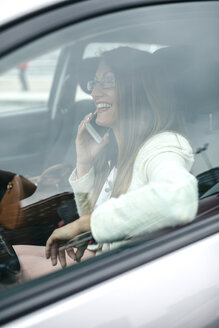 Smiling businesswoman on cell phone in car - DAPF000212