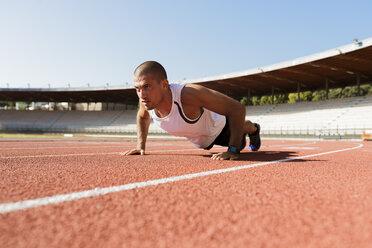 Young sportsman making pushups - FMOF000082