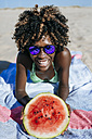 Happy young woman with watermelon on the beach - KIJF000636