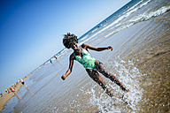 Happy young woman at the seafront - KIJF000645