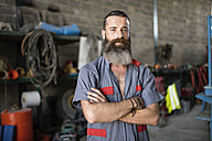 Portrait of confident man in workshop - JASF001052