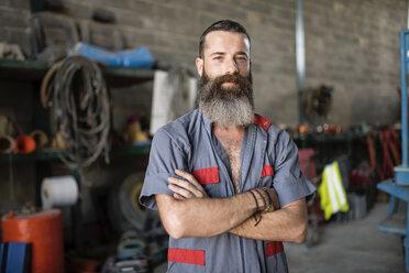 Portrait of confident man in workshop - JASF001052