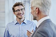 Two businessmen talking together - RORF000215