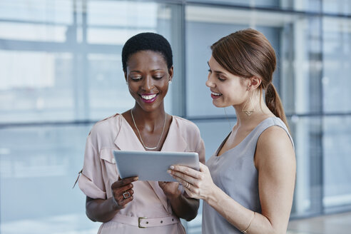 Two businesswomen with digital tablet - RORF000230