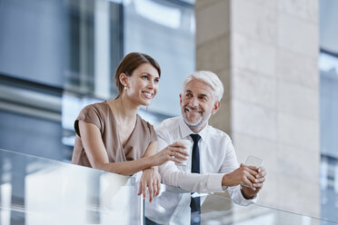 Businessman and woman with coffee and cell phone - RORF000245
