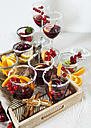 Glasses of Sangria with cherries, red currants and orange slices - VABF000727