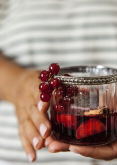 Woman's hands holding glass of Sangria - VABF000733
