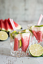 Fresh mineral water with watermelon, lime and ice in glasses - JUNF000553