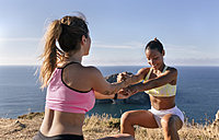 Spain, Asturias, two sportswomen training on the coast - MGOF002174
