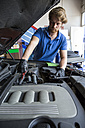 Mechanic checking the oil of a car - ABZF000942