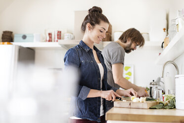 Couple in kitchen preparing food - PESF000300