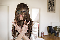 Playful young woman at home - PESF000324