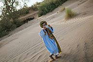 Young Berber taking pictures with a smart phone - KIJF000701