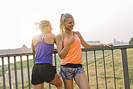 Two sporty young women on bridge - MADF001089
