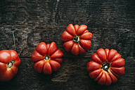 Four homegrown organic oxheart tomatoes on dark wood - IPF000325