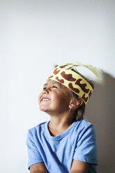 Happy little boy wearing self-made headdress - VABF000743