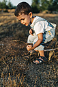 Little boy playing on a field - JRFF000823