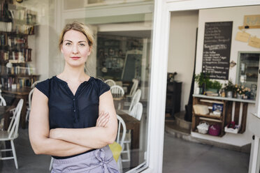 Portrait of confident woman in a cafe - KNSF000194
