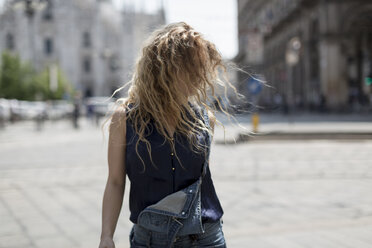 Italy, Milan, young woman tossing her hair - MAUF000807