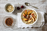 Cherry smoothie bowl with peach and oat flakes, topping - EVGF003046