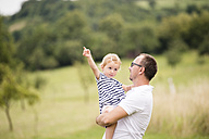 Father carrying little daughter in his arms - HAPF000722