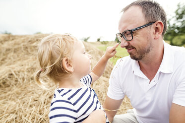 Little girl pointing to father's nose - HAPF000725