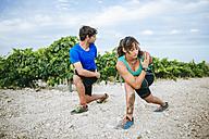 Couple doing sport in a vineyard - KIJF000728