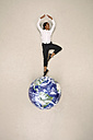 Businesswoman doing a pirouette on globe - BAEF001179