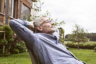 Mature man relaxing in garden - RBF004868