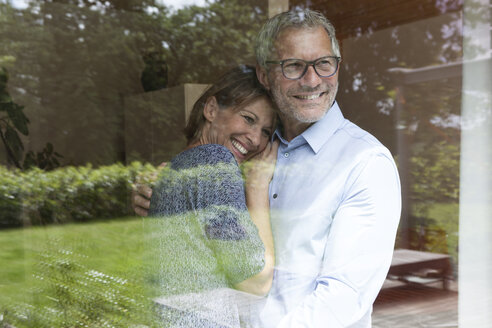 Happy mature couple looking out of window - RBF004898