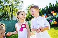Happy little children having birthday party in the garden - HAPF000749