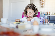 Girl sitting at breakfast table - DIGF000956