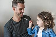 Daughter feeding father - DIGF000962
